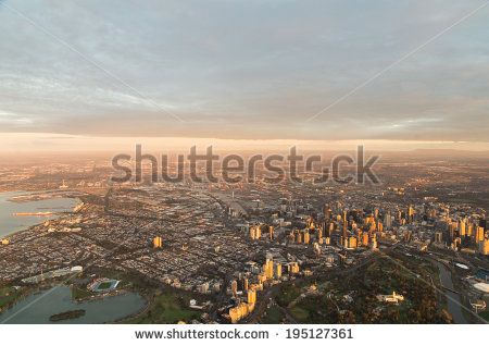 Aerial view of Melbourne, Australia at sunrise.  Albert Park is in the foreground on the left, the botanical garden on the right.
