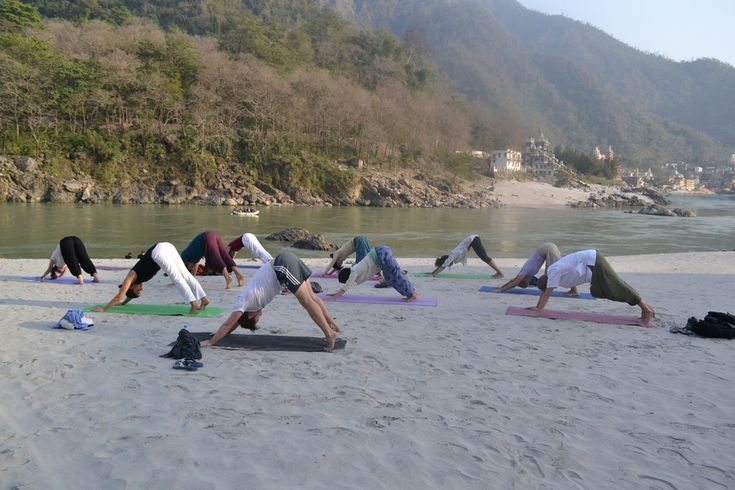 Holy Ganges is 10 minutes walk from the school. So, ending up at the river beach for an early morning yoga session isn't quite new for us. Join outdoor yoga sessions at Jeevmoksha Yoga Gurukul Rishikesh.