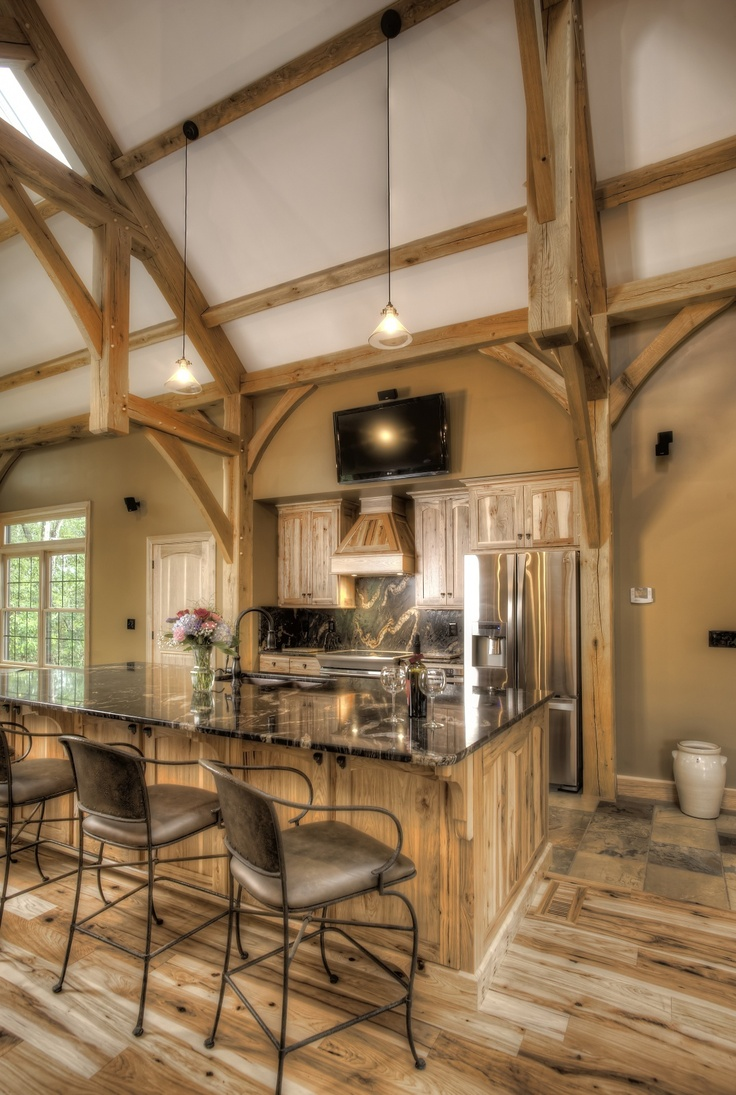 43 best timber home kitchens images on pinterest timber frames the timber frame takes center stage in this kitchen