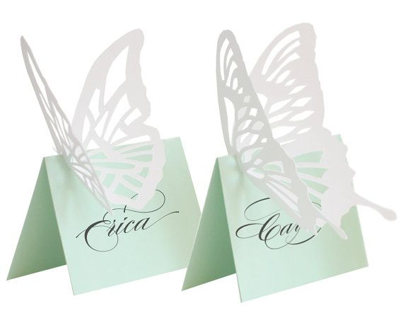 Mint green butterfly escort cards http://www.toptableplanner.com/blog/beveled-glass-and-mint-green-seating-plans