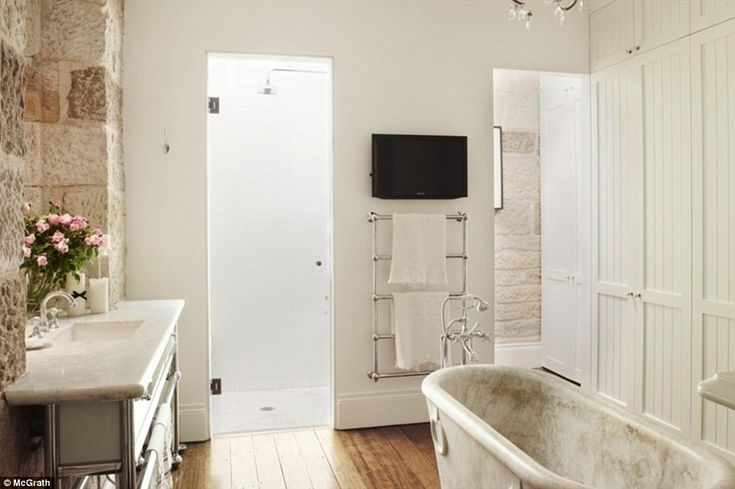 The recently configured lower level master suite features a stand alone marble bathtub...