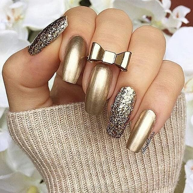Pin for Later: 50 Holiday Nail Art Ideas That Will Put You in a Celebratory Mood New Year's Eve Sparkle