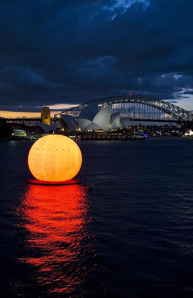 Sun orb in Sydney Harbour for dress rehearsals for Madama Butterfly, which opens on March, Australia