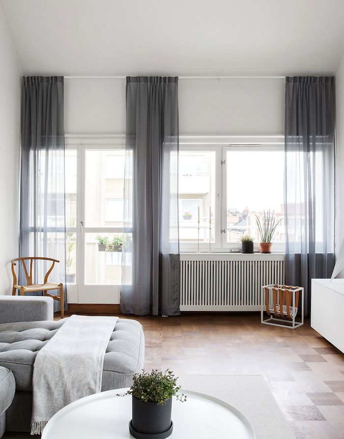 Beautiful soft grey accents, parquet flooring and mainly white walls, with a…