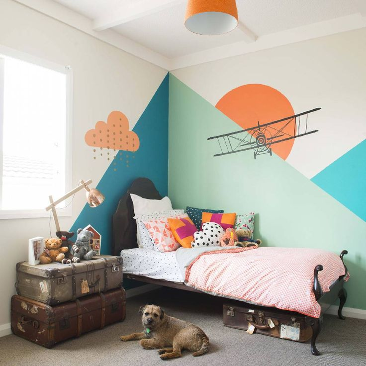 A clever mum painted this abstract mountain scene herself, the airplane  is a decal. #kidsroomcool #yourhomeandgarden  Photo by Helen Bankers.