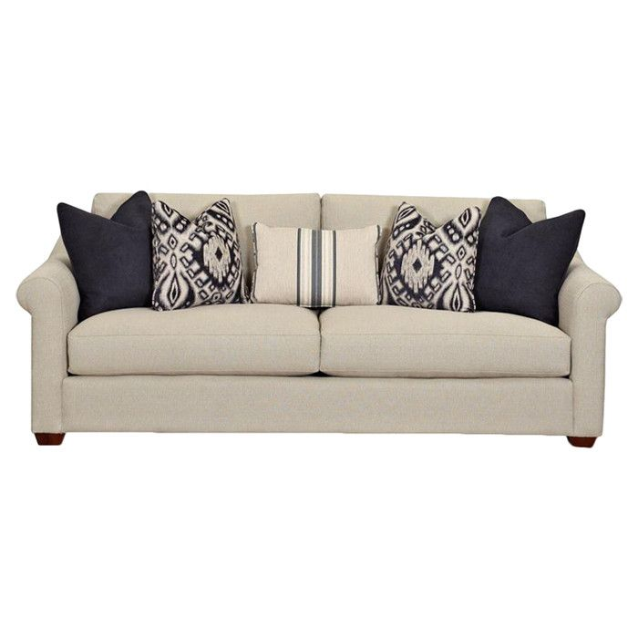 showcasing a classic silhouette and 5 toss pillows this timeless sofa brings cozy style to your living room or den