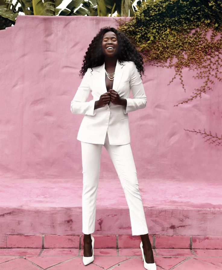 Anyier Youl looks phenomenal in The Aurum Collective's ivory pant suit. Anyier exudes confidence in this sultry trouser suit for the front cover of Lita Magazine. Photography by Heidi Hannele.