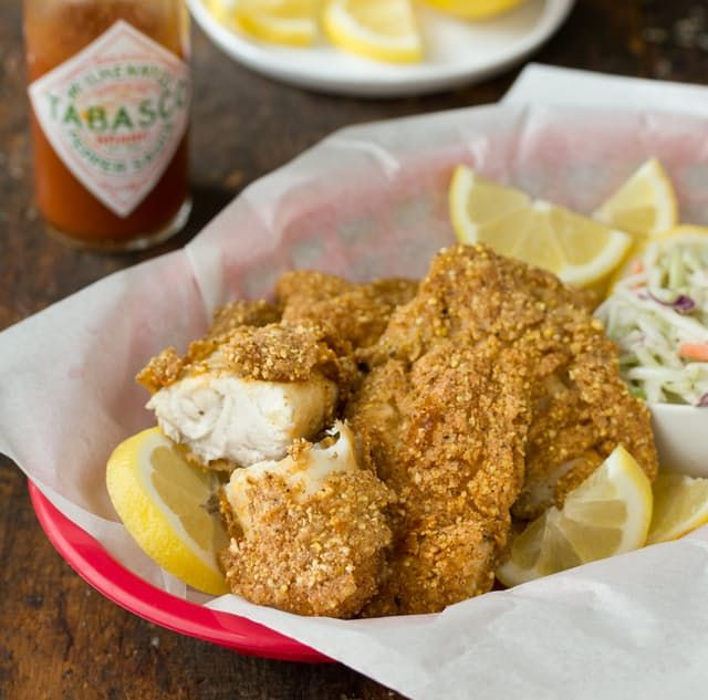 If you don't think you like catfish then somebody didn't do something right. Perfectly fried, Southern-style catfish — whether cooked at a fish shack, at a Saturday night fish fry, or on the banks of a winding river — should not be underestimated. There are countless ways to prepare it, but I like this one best: a quick dip in hot sauce followed by a crunchy cornmeal coating yields the ultimate deep-fried fillet of fish.