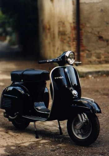 color photo of a Vespa in black and white