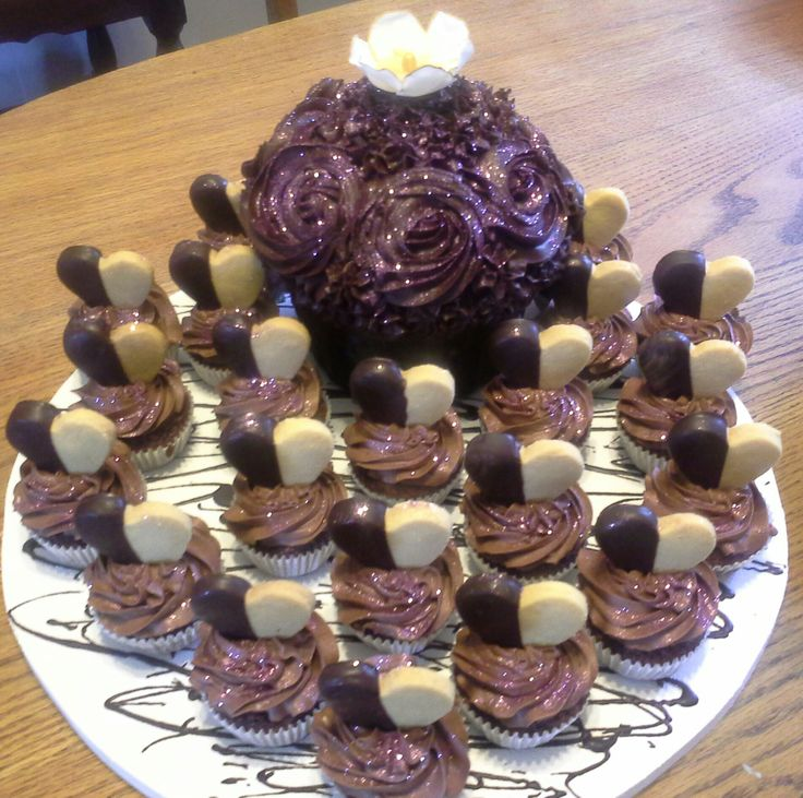Giant cupcake and cupcakes decorated with chocolate dipped shortbread biscuits