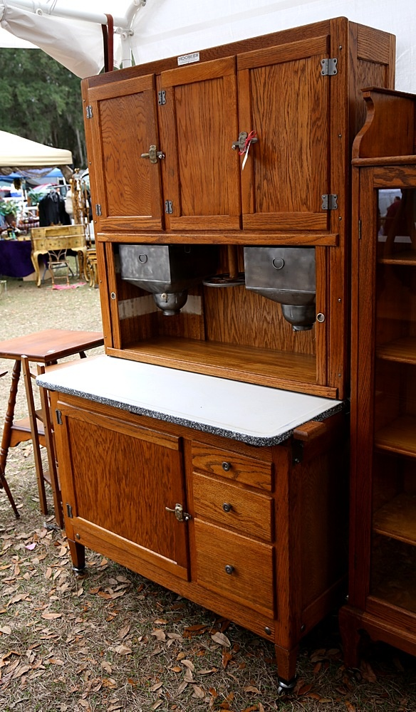 Hoosier Cabinet   Put dishes, silverware, and pots 'n' pans away in one of these after drying dishes. (1950's)