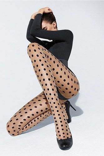 I find this image strangely reminiscent of Robert Palmer's Simply Irresistible ... with awesome polka dots.