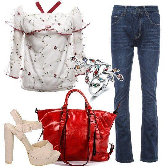 Jeans+bootcut+abbinati+a+splendida+blusa+a+fiori+con+ricami+che+lascia+le+spalle+scoperte.+Completano+il+tutto+sandali+con+plateau,+grande+borsa+a+mano+e+delicato+anello+con+elementi+a+foglia.+Look+perfetto+per+chi+ama+i+tacchi.