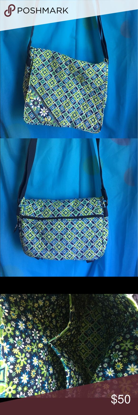 Vera Bradley laptop bag Vera Bradley laptop bag! Blue/green/white design. Adjustable shoulder strap with rubber shoulder pad. Big zipper opening on back. Flap clips shut with two plastic clips. 3 small pockets inside bag. In great condition! Vera Bradley Bags Laptop Bags