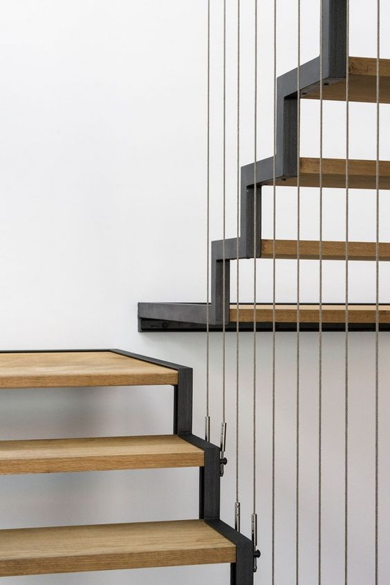 Modern staircase with wire cabling and wood steps