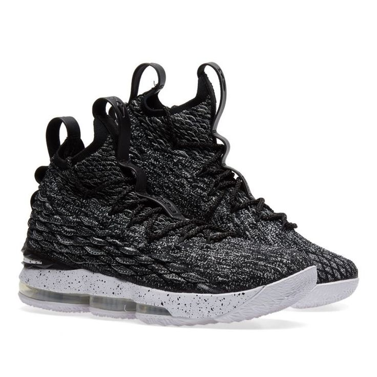 """The king of the court's 15th signature shoe, Nike and LeBron James launch the player's favourite model to date in an """"Ashes"""" colourway. Bringing neutral tones to the court, the sneaker mixes black and white material dyed Flyknit uppers with a black speckled midsole. Maintaining hardwood technologies, the Dynamic Flywire provides the ultimate lockdown to play and flex in, whilst underfoot the combined Max Air and Zoom Air units strengthen its cushioning and impact protection. Flyknit Uppers…"""