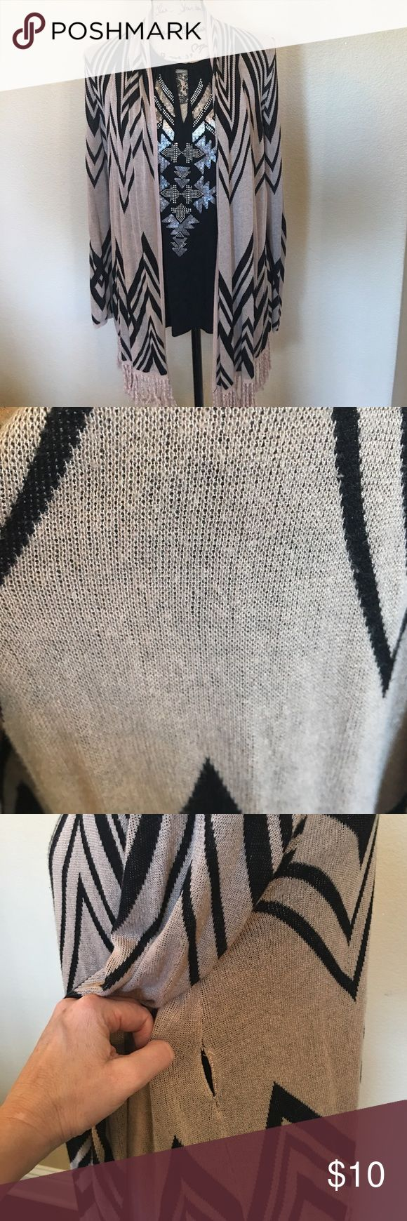INC knit shrug with fringe Stylish and comfy taupe and black Aztec print long knit shrug with knotted fringe. Some overall pilling on closer inspection so I took pic#2 to illustrate that though it's hard to detect. I disclose everything! Also there's about an 1-1 1/2 inch tear below the underarm seam on the left side.  I'm too lazy to fix it so my price reflects that! Shown on top of black INC tank top sold separately. Smoke free home. Quick shipper. INC International Concepts Sweaters…