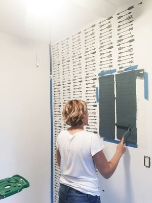 Stenciling an adventure themed nursery accent wall using the Indian Arrows Allover Stencil from Cutting Edge Stencils. http://www.cuttingedgestencils.com/indian-arrows-stencil-pattern-for-walls.html
