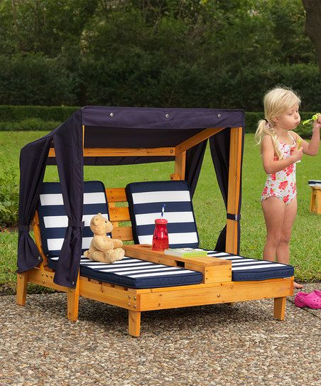 Your little one can lounge in style courtesy of this double chaise chair, boasting a canopy for cozy shade and a center cup holder to hold your little pal's refreshments. This piece's durable wood structure holds strong for all those days of outside lounging.