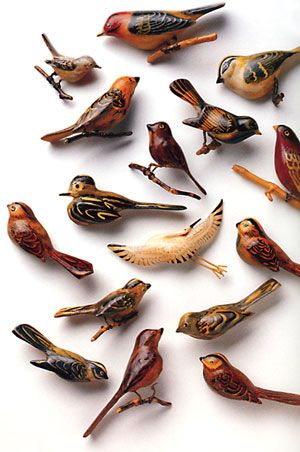 These wooden birds, carved inside World War II-era Japanese American internment camps, are a sampling of the artwork in The Art of Gaman by Delphine Hirasuna. The birds tiny legs were crafted from the surplus snipped off the wire mesh screens over barrack windows.