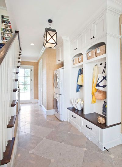 markay johnson beautiful hall and stairway with limestone tiled floors laid in a diamond