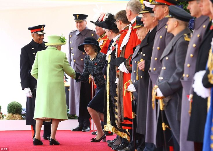 Juan Manuel Santos de Calderon and his wife Maria were formally welcomed by Her Majesty and Theresa May at the Royal Pavilion on Horse Guards Parade. Pictured: Mrs May performs a curtsy for the Queen during theceremonial welcome