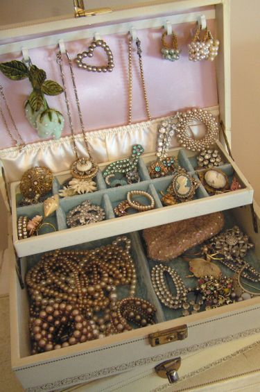 Looking through Mom's jewelry box.