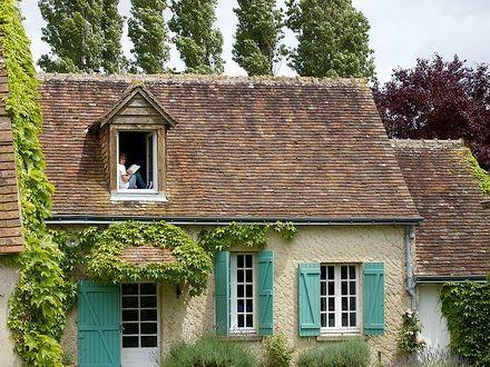Cream Brick Turquoise Shutters White Window Brown Roof