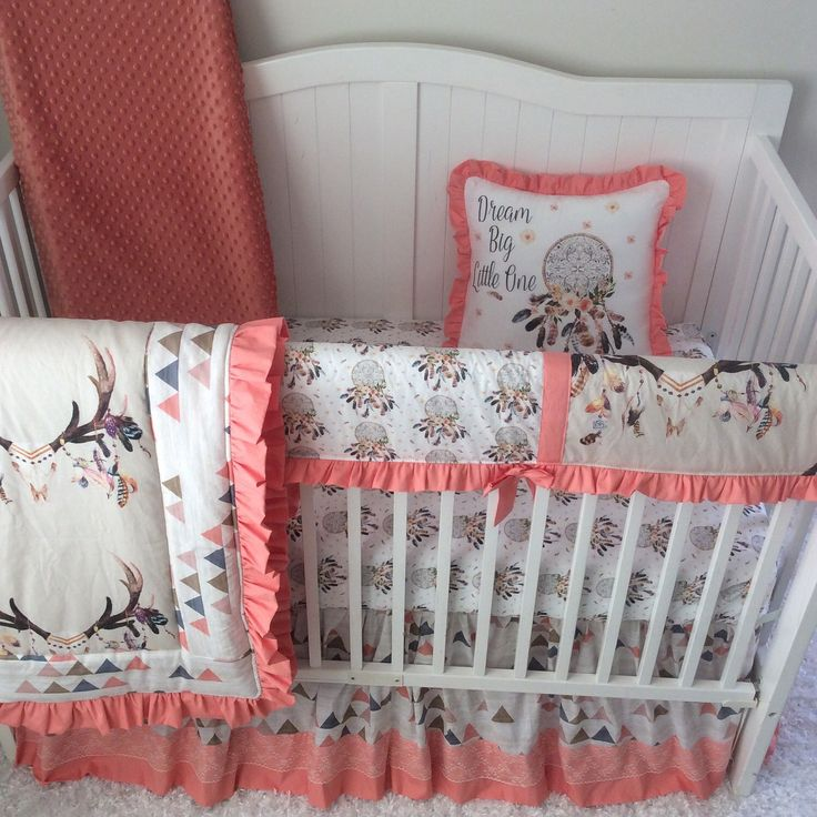 A personal favorite from my Etsy shop https://www.etsy.com/listing/180763393/baby-girl-crib-bedding-set-peach-coral  Coral peach tan blue boho dreamcatcher baby girl crib bedding with deer skull and feathers