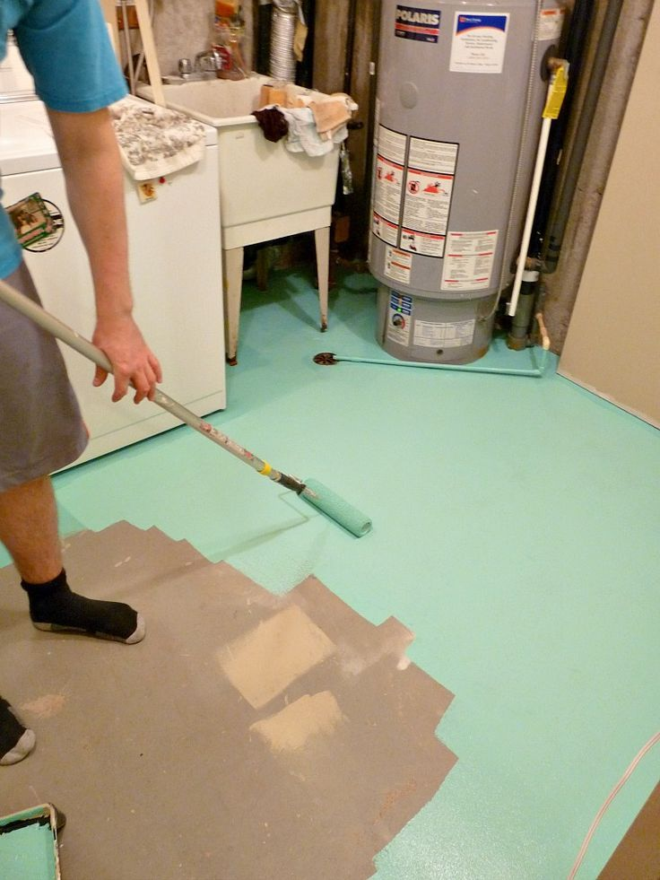 Paint concrete floors a fun colour! I painted mine aqua to brighten up a dreary basement laundry room.