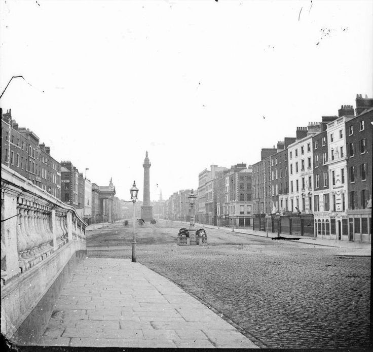 A very early shot of O'Connell Street in Dublin taken from O'Connell Bridge, or Sackville Street from Carlisle Bridge as both were known back then. G.P.O. building and Nelson's Pillar in situ, but no O'Connell Monument. c.1860