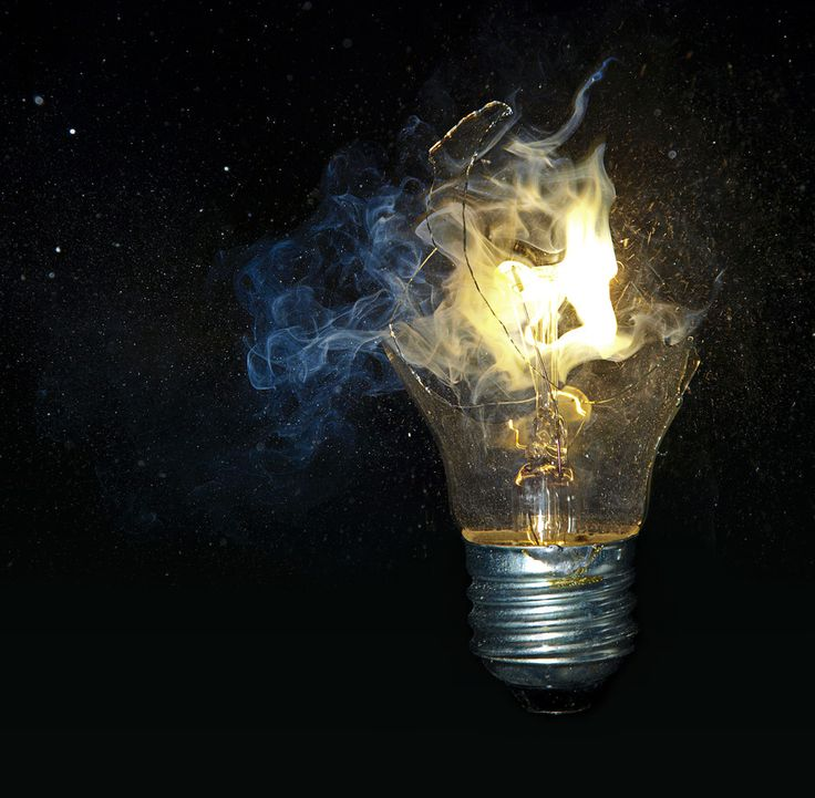 High speep photography of shattered light bulb by J R J - PHOTO