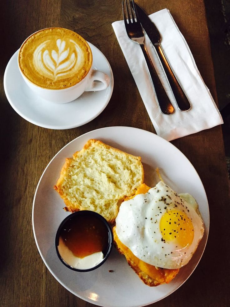 Photo of Blacksmith - Houston, TX, United States. Flat white with the sausage, egg & cheese biscuit (and a side of cream fraiche & marmalade)