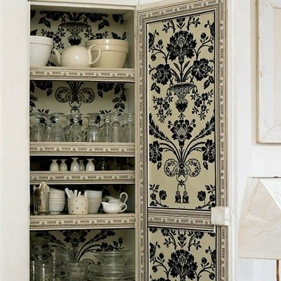 Kitchen armoire lined with fabric. Lovely.