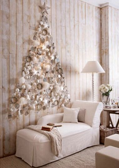 White ornaments on a white wall in the shape of a Christmas tree.. unique!