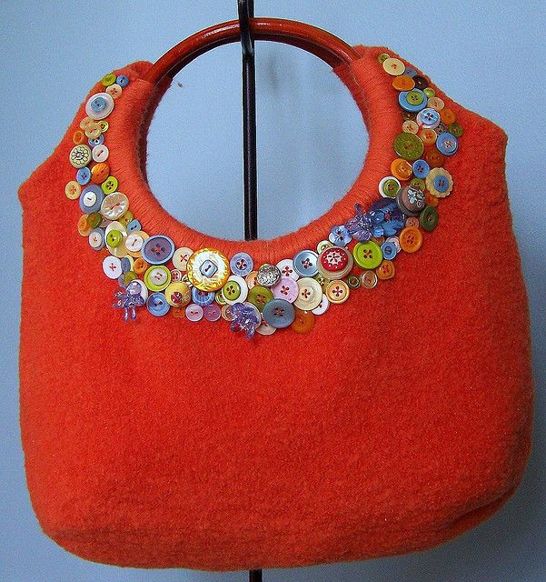 Button adorned handbag tote.  Buttons!!  What a cute way to finish off a felted purse!