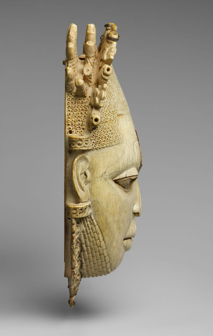 Queen Mother Pendant Mask: Iyoba Date: 16th century Geography: Nigeria, Court of Benin Culture: Edo peoples Medium: Ivory, iron, copper (?) Dimensions: H. 9 3/8 x W. 5 x D. 3 1/4 in. (23.8 x 12.7 x 8.3 cm) Classification: Bone/Ivory-Sculpture