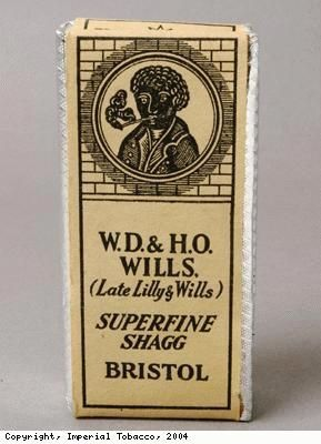 """One side of a packet of WD and HO Wills' Superfine Shagg tobacco, possibly from the 1950s  """"Even after the freeing of slaves in America in 1865, many African Americans continued to work on the tobacco and cotton plantations where they had previously worked as slaves. This, and the attitude to black people generally, was reflected in the continued use of the image of a black man or woman on British tobacco packaging and advertising until about 1960."""""""