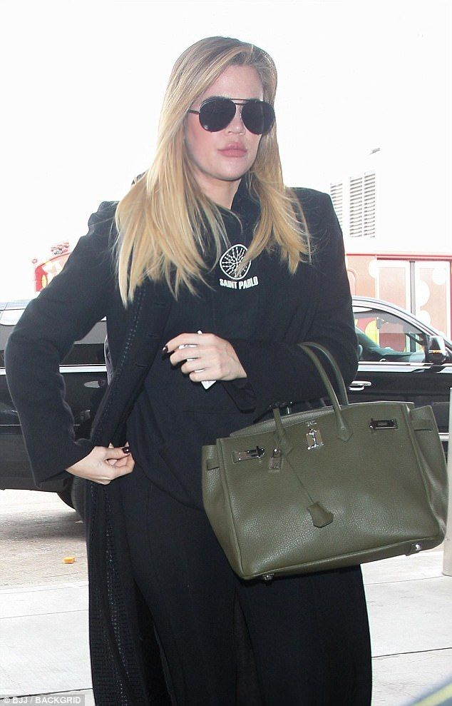 3a6327a71408 What she hiding   Pregnant  Khloe Kardashian hid her midsection with a green  Birkin on Wednesday as she prepared to jet out of LAX