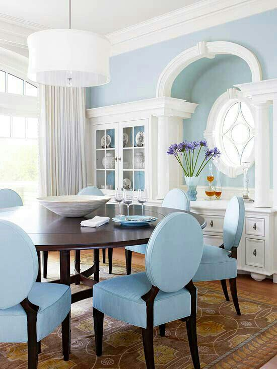 Classic meets contemporary styling in pale blue and white. This dining room  has the same