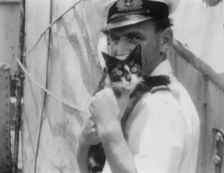 August 1949: Able Seacat Simon and Commissioned Gunner (Sub-Lieutenant) E. Monaghan seen in Hong Kong after the escape of HMS Amethyst from ...