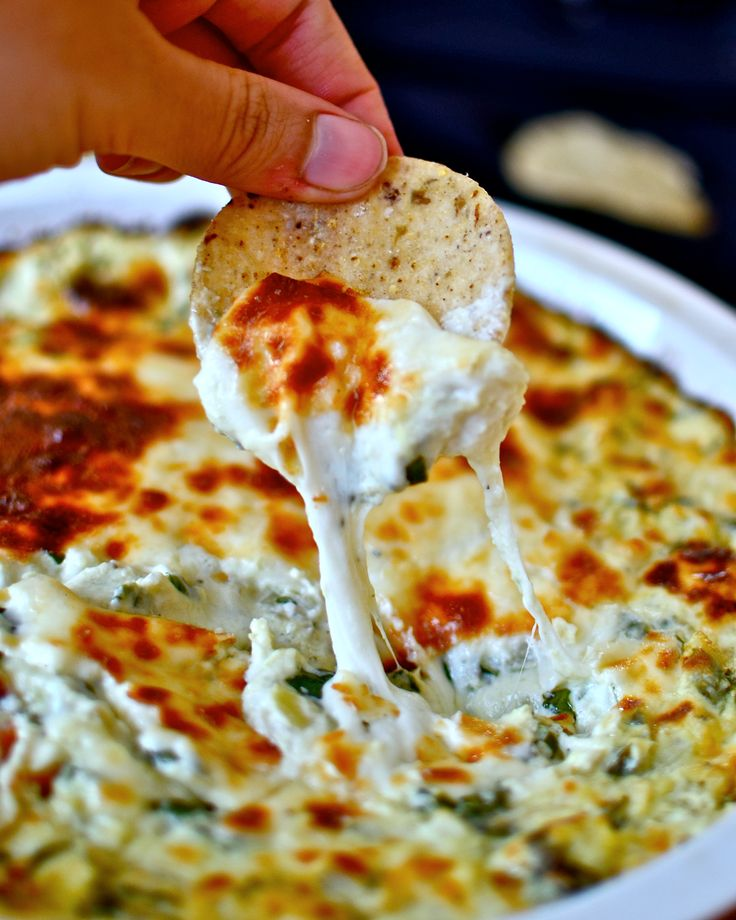The gooiest, cheesiest, most easy and delicious spinach artichoke dip in the whole wide world.