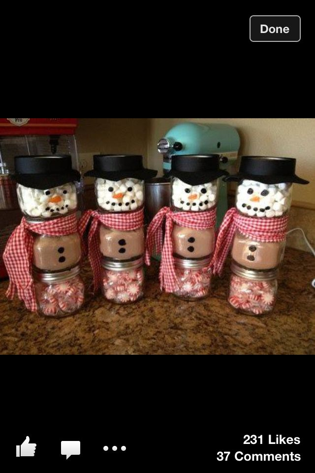 Get three jars, fill one with marshmallows, one with powdered hot chocolate, and one with mints, glue the bottom or the jar to the lid of the one below, add decorations and voila! A simple homemade Christmas hot chocolate kit perfect for a gift! I am so doing this!
