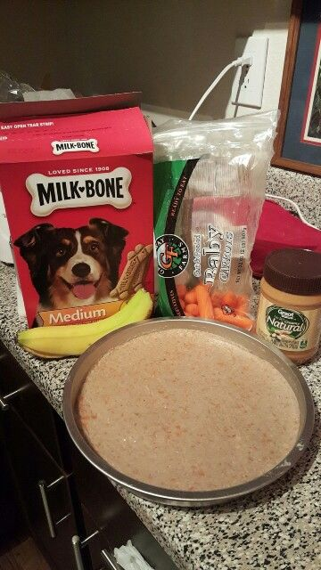 Easy Dog Birthday Cake Ingredients: Milk bone treats 2 bananas Carrots (or any vegetable your dog likes) 1 cup of water Peanut butter First in a blender or food processor put in the treats and blend until powdery. Next, separately blend the bananas, carrots, and water until it looks kind of like a smoothie. Afterwards, mix the banana mixture in with the treats and pour it into a baking pan. Bake at 365° for 15 minutes After it cools down frost with peanut butter and enjoy!