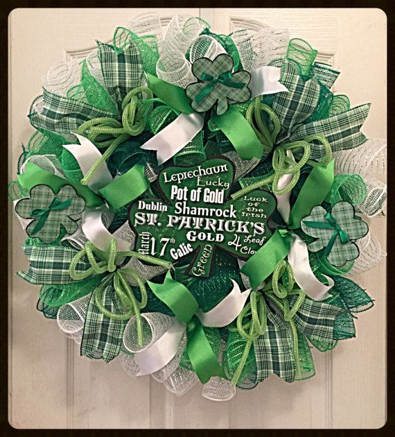 You will enjoy celebrating the month of March with this St Patricks Day Deco Mesh Shamrock Wreath hanging in your home or on your covered front porch- It is made with high quality green, lime and white metallic deco mesh- There are numerous ribbons in green plaid, lime and silky