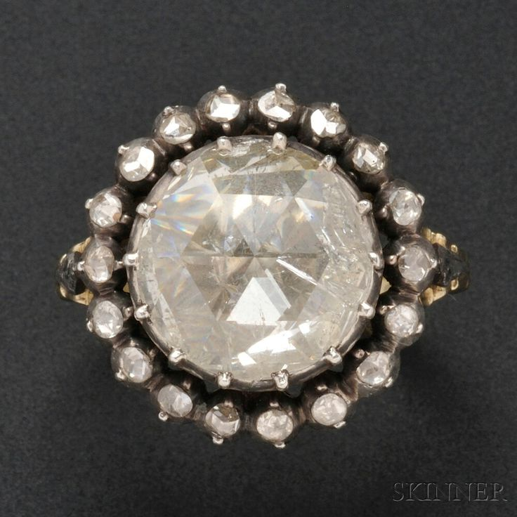 Antique Rose-cut Diamond Ring, collet-set with a circular rose-cut diamond measuring approx. 12.50 mm, and framed by rose-cut diamonds, silver-topped gold mount. Probably Georgian