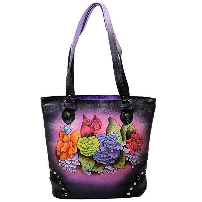 purple black hand painted leather bag Trendy, Cute and Luxurious Hand Painted Leather Purses Hand painted leather purses are truly eye-catching, unique and cool. In fact they are currently trending like crazy! Obviously when you combine beautiful hand painted art, on fine quality leather the result is a timeless and charming creation just for you.