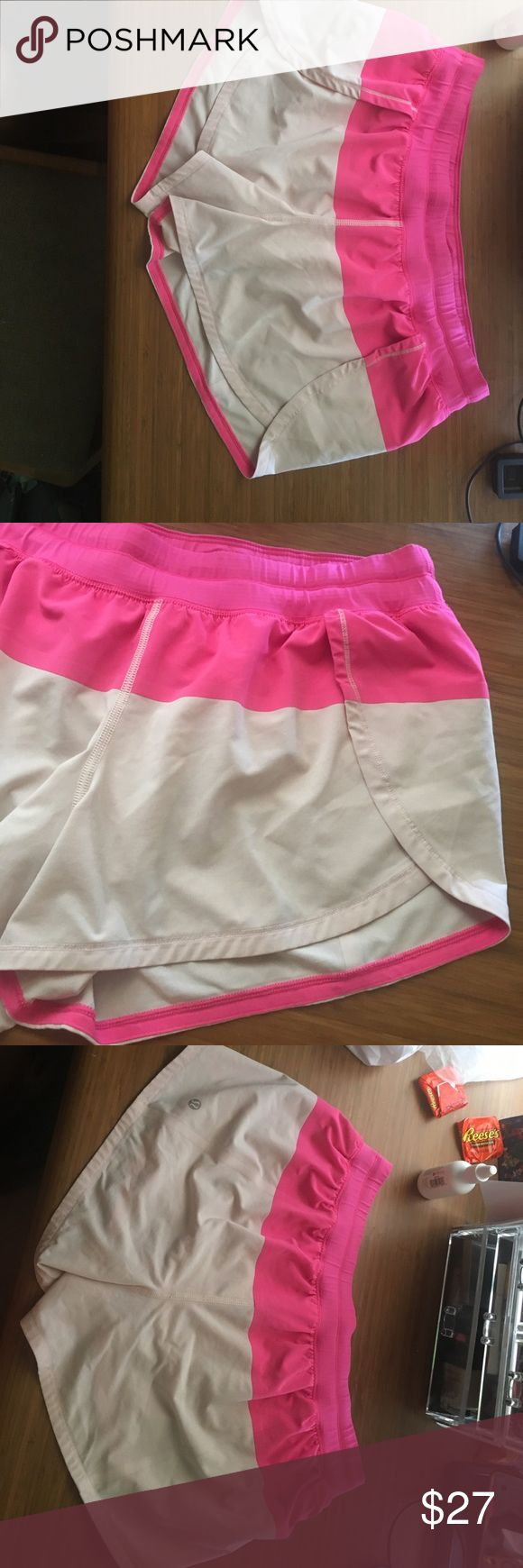 Lululemon pink shorts sz10 Hot pink and light pink lululemon shorts. Size 10 but no tag or dot. Barely worn, cute like open running short type in the front with built in undies. Only worn like twice because they're too small on me. Perfect Lulu symbol on back bottom left lululemon athletica Shorts