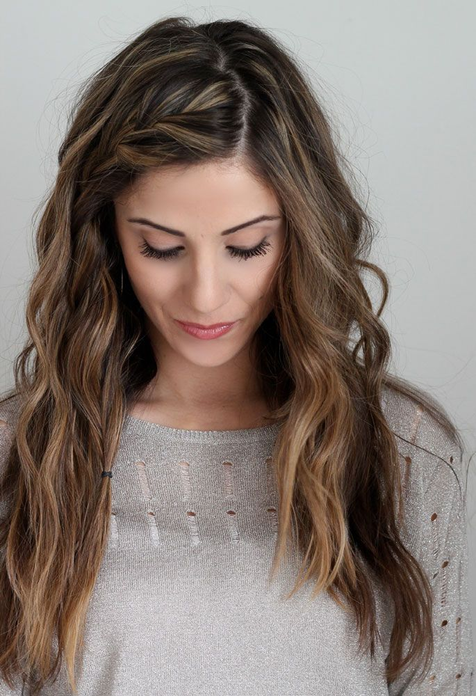If you have bangs you would like to keep out of your face or simply want a more easy approach to keeping your hair back, braid along the hairline, pin it back or wrap an elastic around it, and style the rest of your hair as you would.