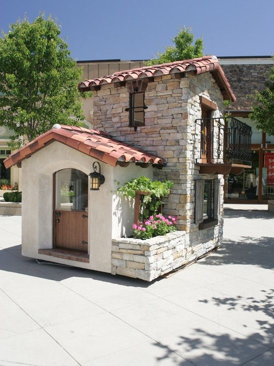 This Mediterranean-style playhouse is gorgeous - can we move in!?